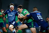 Ben Smith of the Highlanders is tackled by Lolagi Visinia of the Blues during the round 18 Super Rugby match between the Blues and the Highlanders at...