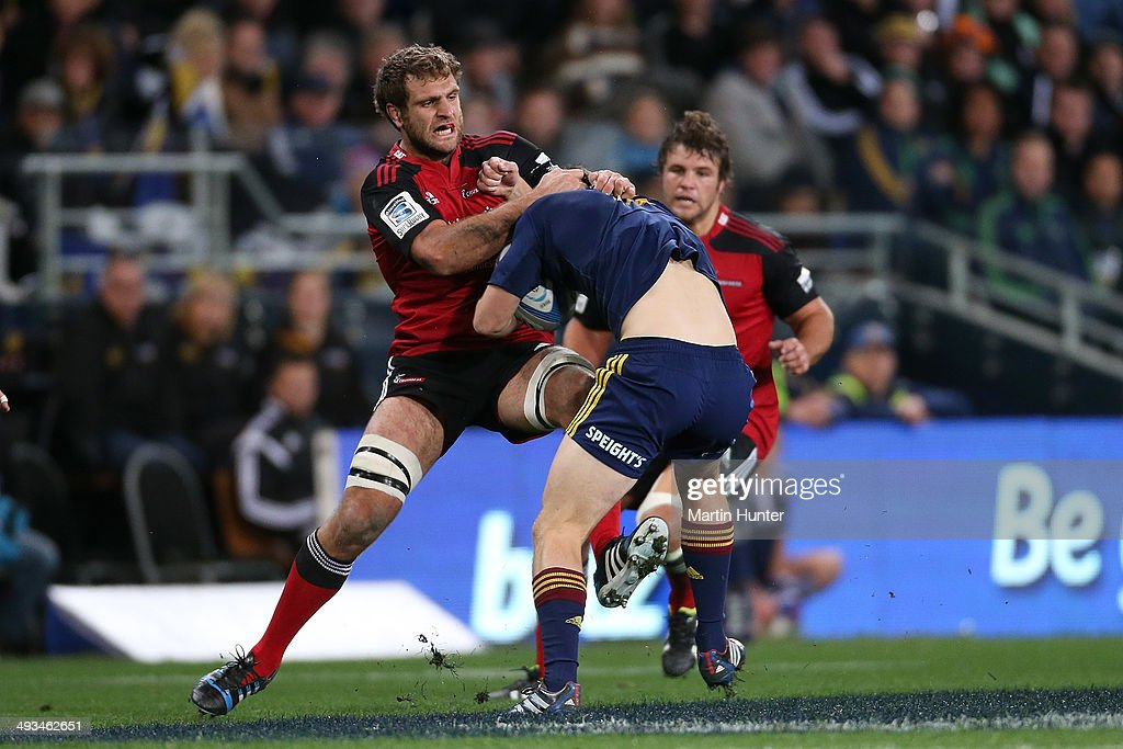 Ben Smith of the Highlanders is tackled by <a gi-track='captionPersonalityLinkClicked' href=/galleries/search?phrase=Luke+Whitelock&family=editorial&specificpeople=7045783 ng-click='$event.stopPropagation()'>Luke Whitelock</a> of the Crusaders during the round 15 Super Rugby match between the Highlanders and the Crusaders at Forsyth Barr Stadium on May 24, 2014 in Dunedin, New Zealand.