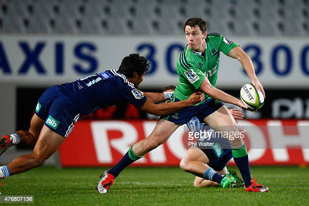 Ben Smith of the Highlanders is tackled by Melani Nanai of the Blues during the round 18 Super Rugby match between the Blues and the Highlanders at...