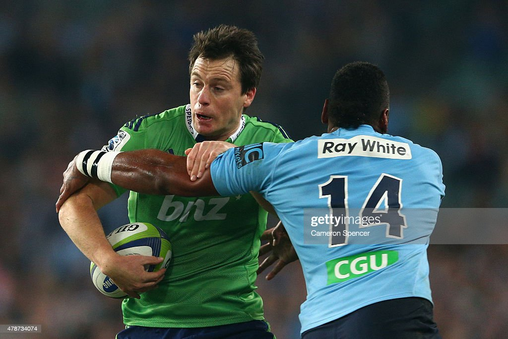 Ben Smith of the Highlanders is tackled during the Super Rugby Semi Final match between the Waratahs and the Highlanders at Allianz Stadium on June...