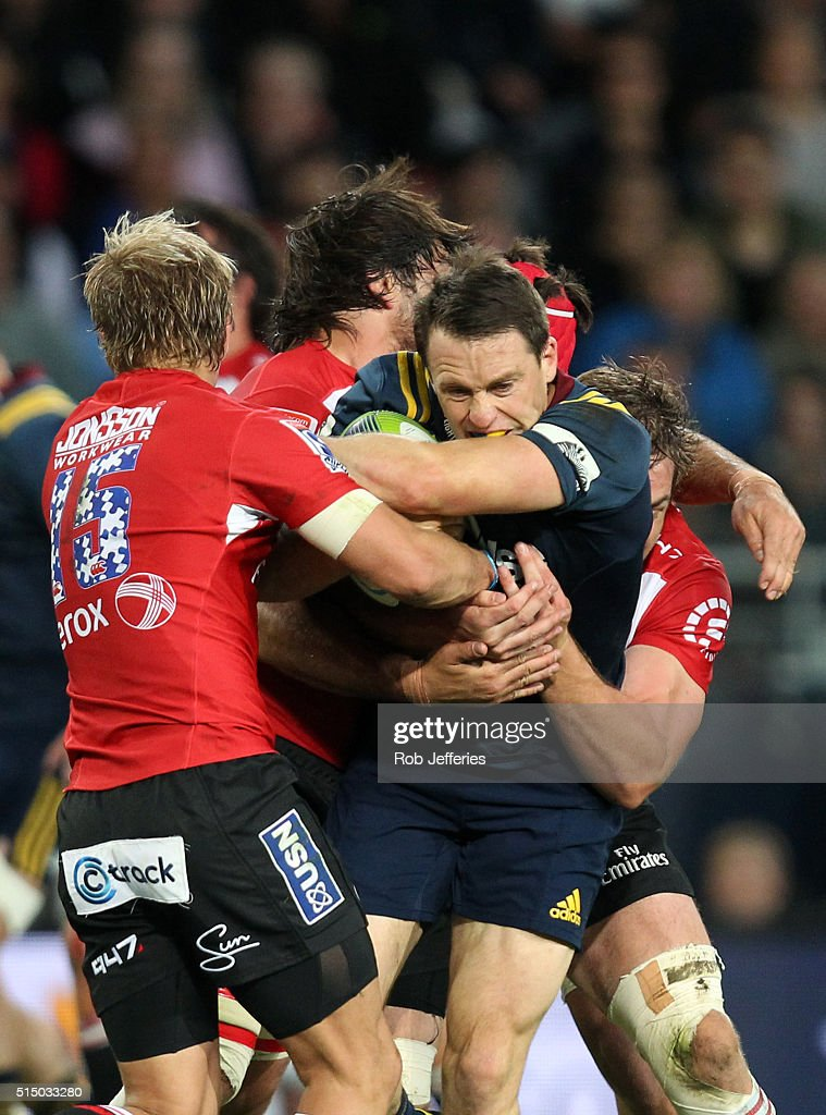 Ben Smith of the Highlanders looks to bust the Lions defence during the round three Super Rugby match between the Highlanders and the Lions at Rugby Park on March 12, 2016 in Dunedin, New Zealand.