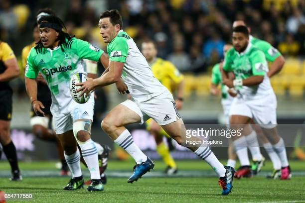 Ben Smith of the Highlanders makes a break during the round four Super Rugby match between the Hurricanes and the Highlanders at Westpac Stadium on...