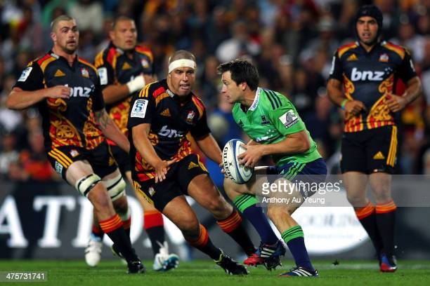 Ben Smith of the Highlanders makes a run at Rhys Marshall of the Chiefs during the round three Super Rugby match between the Chiefs and the...