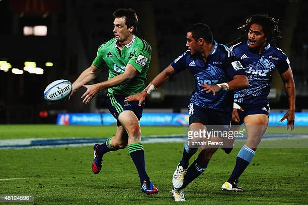 Ben Smith of the Highlanders offloads the ball during the round seven Super Rugby match between the Blues and the Highlanders at Eden Park on March...