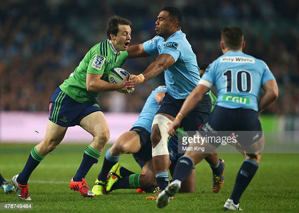 Ben Smith of the Highlanders takes on the defence during the Super Rugby Semi Final match between the Waratahs and the Highlanders at Allianz Stadium...