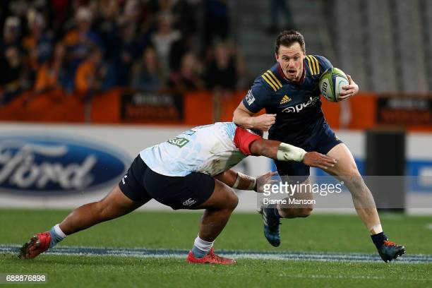 Ben Smith of the Highlanders tries to break a tackle during the round 14 Super Rugby match between the Highlanders and the Waratahs at Forsyth Barr...