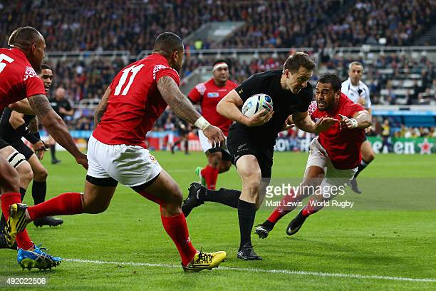 Ben Smith of the New Zealand All Blacks breaks through to score the first try during the 2015 Rugby World Cup Pool C match between New Zealand and...