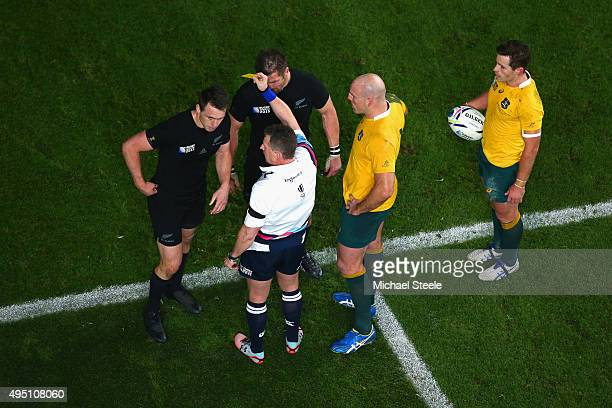 Ben Smith of the New Zealand All Blacks is shown a yellow card and sent to the sin bin by Referee Nigel Owens during the 2015 Rugby World Cup Final...