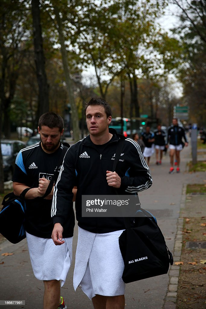 Ben Smith of the New Zealand All Blacks walks back from a pool recovery session on November 4, 2013 in Paris, France.