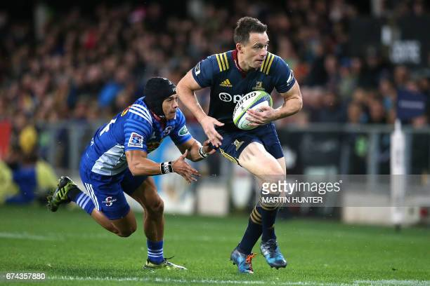 Ben Smith of the Otago Highlanders breaks away from the tackle of Cheslin Kolbe of the Western Stormers during the Super Rugby match between the...