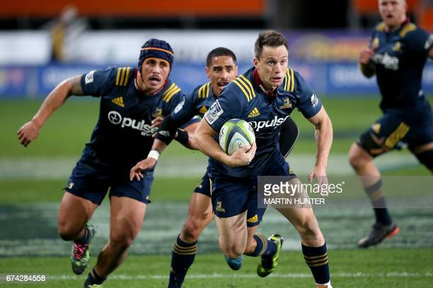 Ben Smith of the Otago Highlanders makes a break with the ball during the Super Rugby match between the Otago Highlanders of New Zealand and the...