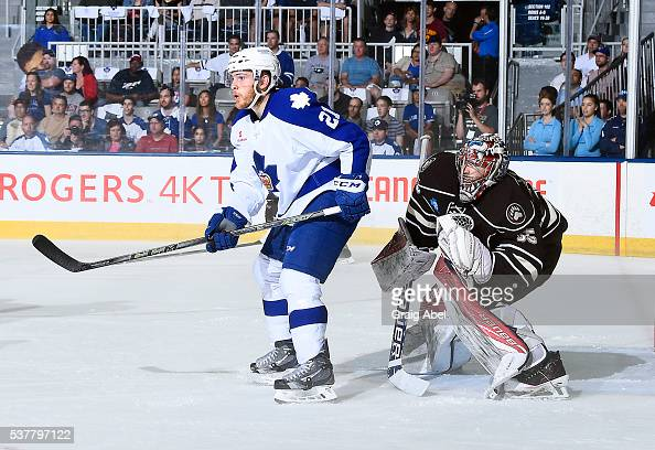 Ben Smith of the Toronto Marlies puts a screen on Justin Peters of the Hershey Bears during AHL Eastern Conference Final playoff game action on May...