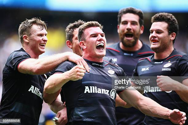 Ben Spencer of Saracens celebrates scoring his team's fourth try with team mates during the Aviva Premiership match between Saracens and Worcester...