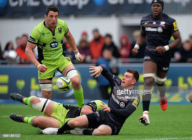 Ben Spencer of Saracens is tackled by Gareth Denman of Northampton Saints during the LV= Cup Semi Final match between Saracens and Northampton Saints...