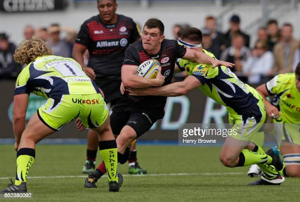 Ben Spencer of Saracens tackled by Tom Curry of Sale Sharks during the Aviva Premiership match between Saracens and Sale Sharks at Allianz Park on...