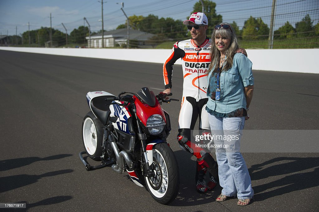 Ben Spies of USA and Ignite Pramac Racing Team poses with his mother during the test of Ducati Diavel on track during the MotoGp Red Bull US...