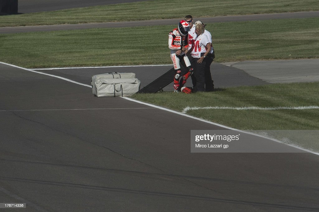 Ben Spies of USA and Ignite Pramac Racing Team with doctor after crashed out during the MotoGp Red Bull US Indianapolis Grand Prix Qualifying at...
