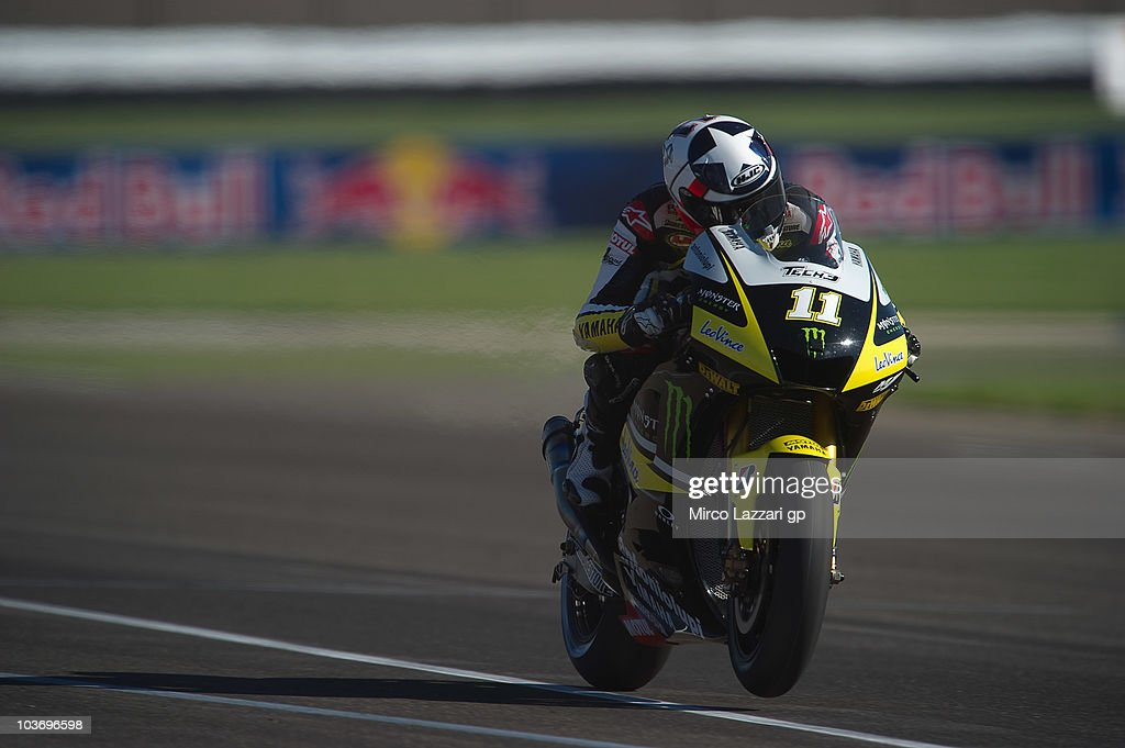 Ben Spies of USA and Monster Yamaha Tech 3 lifts the front wheel during the second free practice during the Red Bull Indianapolis Moto GP at...