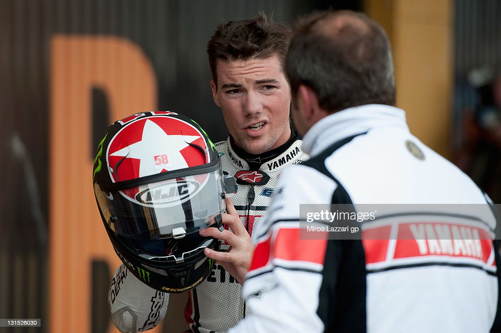 Ben Spies of USA and Yamaha Factory Racing celebrates with team at the end of the qualifying practice of MotoGP of Valencia at Ricardo Tormo Circuit...