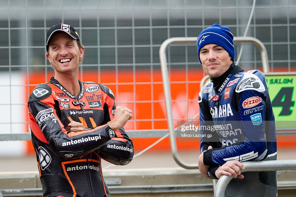 Ben Spies of USA and Yamaha Factory Team speaks with Colin Edwards of USA and NGM Mobile Forward Racing in pit during the free practice of the MotoGP...