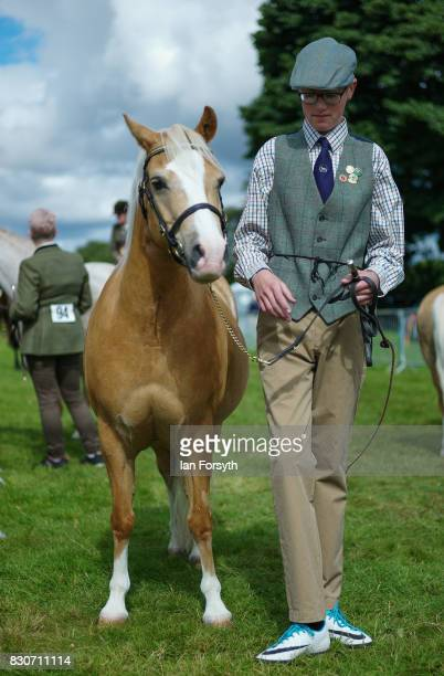 Ben Spoor from Doncaster stands with his horse before competing during the 194th Sedgefield Show on August 12 2017 in Sedgefield England The annual...