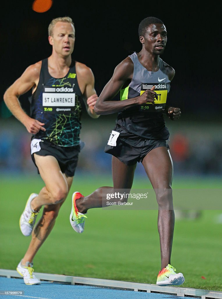 Ben St Lawrence (L) of New South Wales and race winner Emmanuel Bett compete in the Mens 10000 Meters Open during the Zatopek Classic at Lakeside Stadium on December 8, 2012 in Melbourne, Australia.