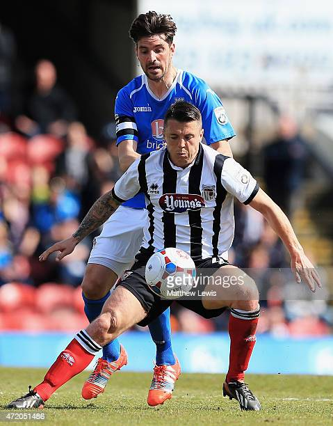 Ben Stevens of Eastleigh and Scott Brown of Grimsby Town challenge for the ball during the Vanarama Football Conference League match between Grimsby...