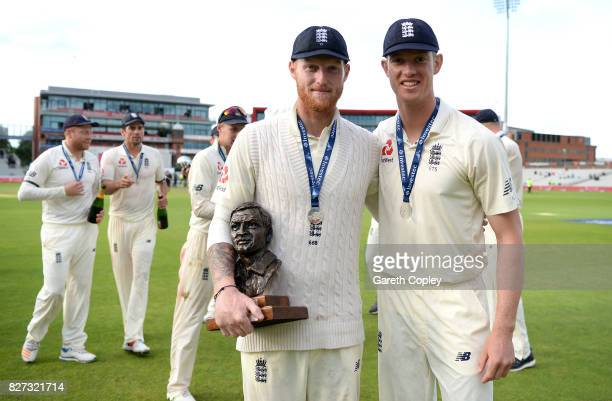 Ben Stokes and Keaton Jennings of England celebrate with the series trophy after winning the Investec Test series between England and South Africa at...