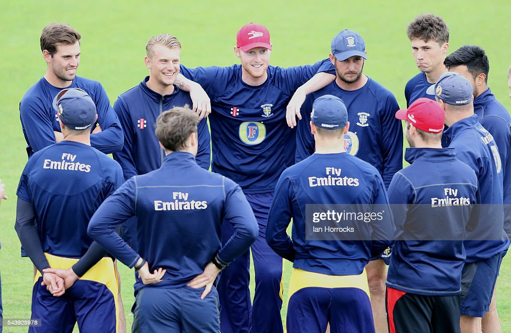 <a gi-track='captionPersonalityLinkClicked' href=/galleries/search?phrase=Ben+Stokes&family=editorial&specificpeople=6688979 ng-click='$event.stopPropagation()'>Ben Stokes</a> of Durham (C) leans on team-mate <a gi-track='captionPersonalityLinkClicked' href=/galleries/search?phrase=Phil+Mustard&family=editorial&specificpeople=824851 ng-click='$event.stopPropagation()'>Phil Mustard</a> (R) and <a gi-track='captionPersonalityLinkClicked' href=/galleries/search?phrase=Scott+Borthwick&family=editorial&specificpeople=5644012 ng-click='$event.stopPropagation()'>Scott Borthwick</a> (L) whilst warming up during the NatWest T20 Blast game between Durham Jets and Worcestershire Rapids at Emirates Durham ICG on June 30, 2016 in Chester-le-Street, England.