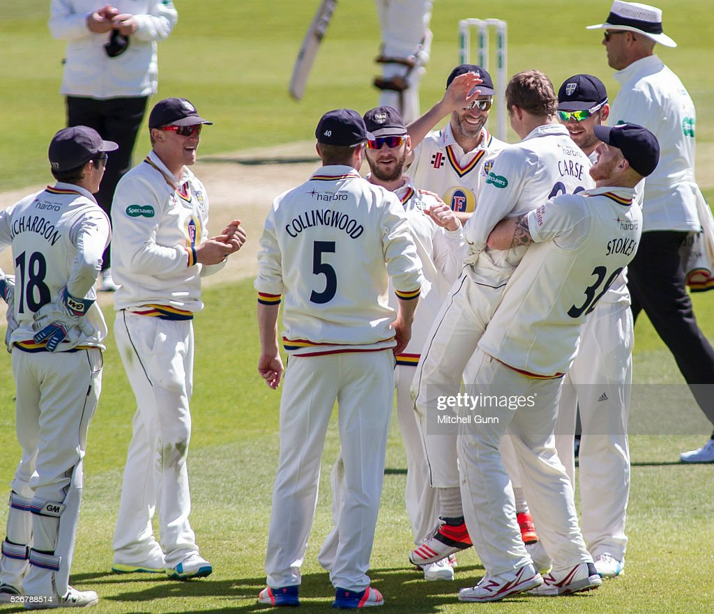 <a gi-track='captionPersonalityLinkClicked' href=/galleries/search?phrase=Ben+Stokes&family=editorial&specificpeople=6688979 ng-click='$event.stopPropagation()'>Ben Stokes</a> of Durham lifts up Brydon Carse as they celebrate the wicket of Kumar Sangakara during the Specsavers County Championship Division One match between Surrey and Durham at the Kia Oval Cricket Ground, on May 01, 2016 in London, England.