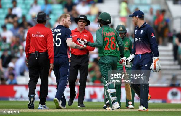 Ben Stokes of England and Tamin Iqbal of Bangladesh exchange words during the ICC Champions Trophy group match between England and Bangladesh at The...
