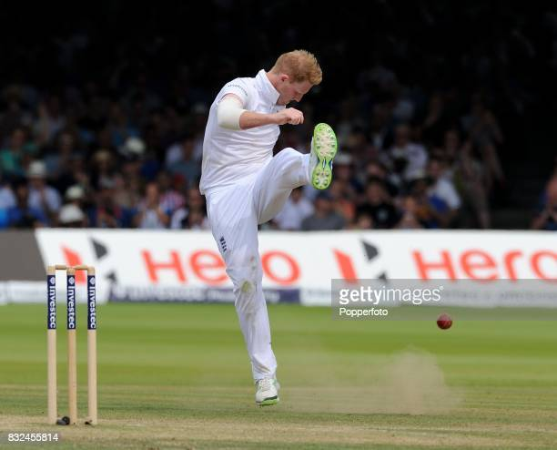 Ben Stokes of England celebrates by kicking the ball after taking the wicket of Bhuvneshwar Kumar of India during Day 4 of the 2nd Test between...