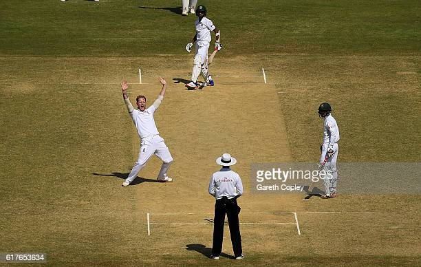 Ben Stokes of England celebrates taking the final wicket of Shafiul Islam of Bangladesh to win the first Test between Bangladesh and England at Zohur...