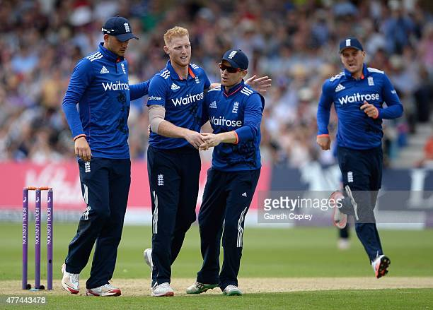 Ben Stokes of England celebrates with Alex Hales and England captain Eoin Morgan after dismissing Martin Guptill of New Zealand during the 4th ODI...