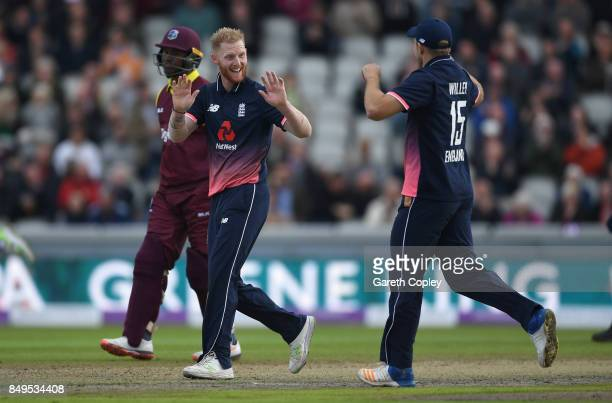 Ben Stokes of England celebrates with David Willey after dismissing Shai Hope of the West Indies during the 1st Royal London One Day International...