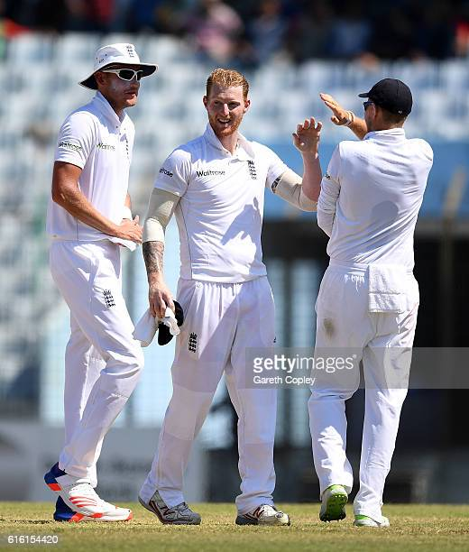 Ben Stokes of England celebrates with Joe Root and Stuart Broad after dismissing Kamrul Islam Rabbi of Bangladesh during the 3rd day of the 1st Test...