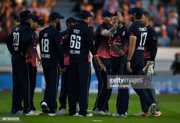 Ben Stokes of England celebrates with teammates after catching out David Miller of South Africa during the 1st Royal London ODI match between England...