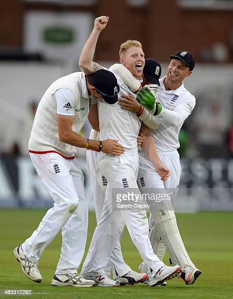 Ben Stokes of England celebrates with teammates Steven Finn and Jos Buttler after dismissing Mitchell Johnson of Australia during day two of the 4th...