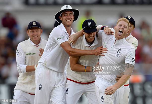 Ben Stokes of England celebrates with teammates Stuart Broad and Steven Finn after dismissing Mitchell Johnson of Australia during day two of the 4th...