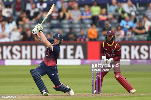 Ben Stokes of England hits a six off the bowling of Ashley Nurse as wicketkeeper Shai Hope of West Indies looks on during the third Royal London One...
