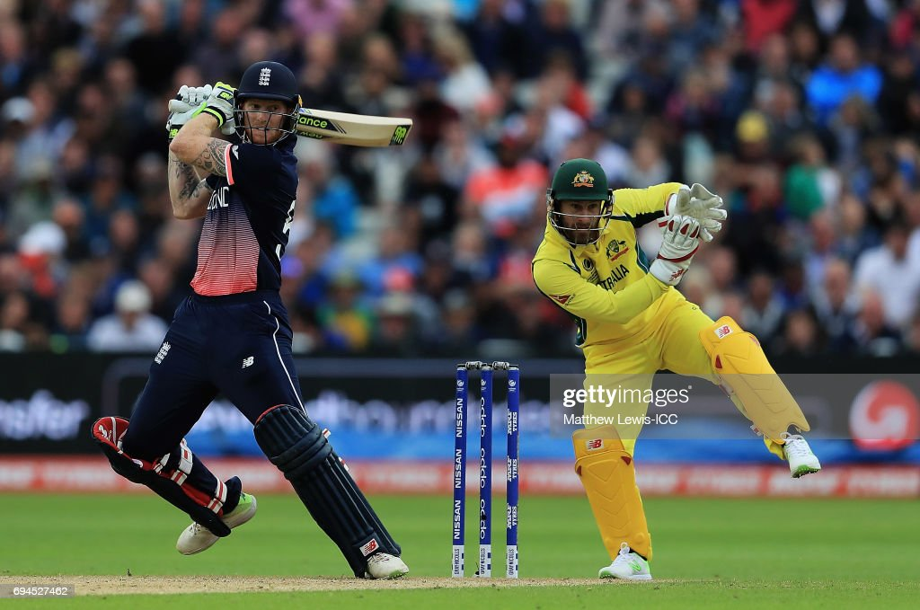 Ben Stokes of England hits the ball towards the boundary, as Matthew Wade of Australia looks on during the ICC Champions Trophy match between England and Australia at Edgbaston on June 10, 2017 in Birmingham, England.