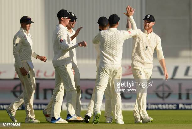 Ben Stokes of England is congratulated after catching Kagiso Rabada of South Africa during the second day of the 4th Investec Test match between...