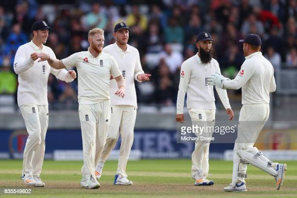 Ben Stokes of England is congratulated by Toby RolandJones after taking the wicket of Shai Hope during day three of the 1st Investec Test match...