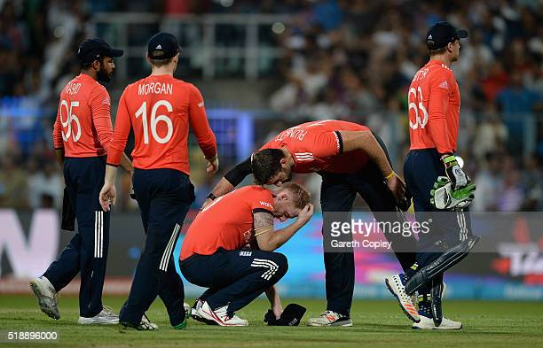 Ben Stokes of England is consoled by Liam Plunkett after losing the ICC World Twenty20 India 2016 Final between England and the West Indies at Eden...