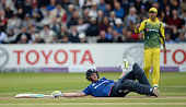 Ben Stokes of England is lies on the ground after avoiding a ball thrown by Mitchell Starc of Australia he was given out for disrupting the field for...