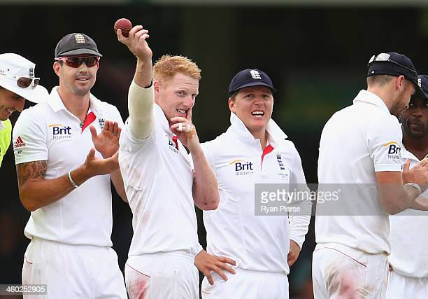 Ben Stokes of England raises the ball after claming his fifth wicket during day one of the Fifth Ashes Test match between Australia and England at...