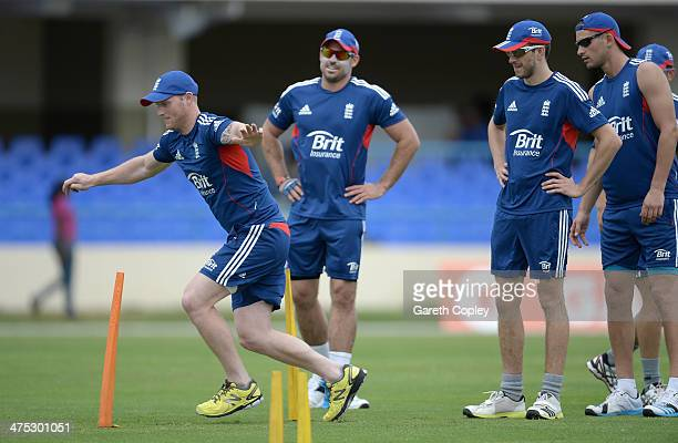 Ben Stokes of England warms up watched by Michael Lumb Harry Gurney and Alex Hales of England during a nets session at Sir Vivian Richards Stadium on...