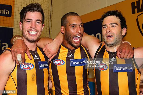 Ben Stratton Josh Gibson and Jordan Lewis of the Hawks sing the song in the rooms after winning the AFL First Preliminary FInal match between the...