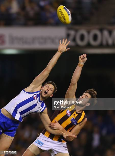 Ben Stratton of the Hawks and Aaron Black of the Kangaroos compete for the ball during the round 22 AFL match between the North Melbourne Kangaroos...