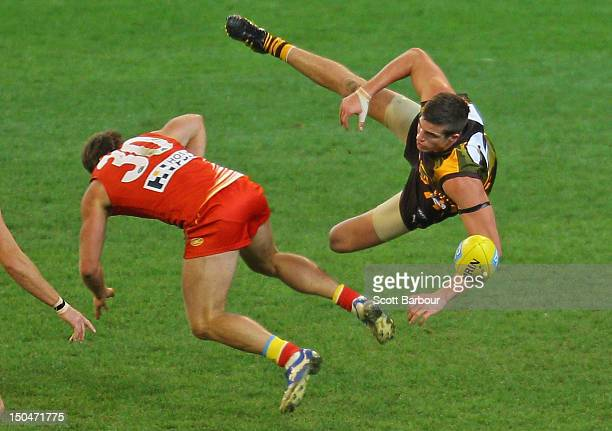 Ben Stratton of the Hawks and Campbell Brown of the Suns compete for the ball during the round 21 AFL match between the Hawthorn Hawks and the Gold...